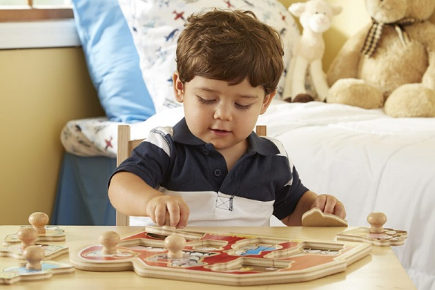 Kid play with Wooden Puzzles