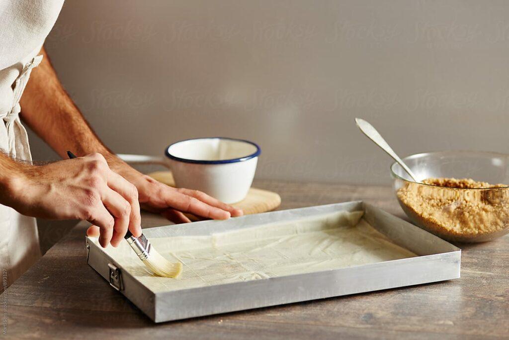 baking pan hands cooking
