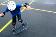 picture of child riding skateboard making tricks with skateboard safety gear