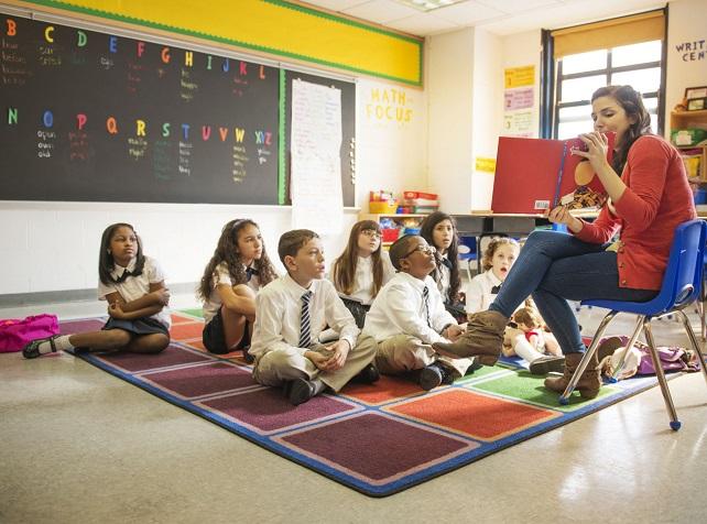 Close-up of teacher teaching kids