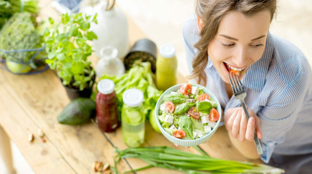 woman-eating-healthy-salad-young-microbiome-diet-dt-FEATURE