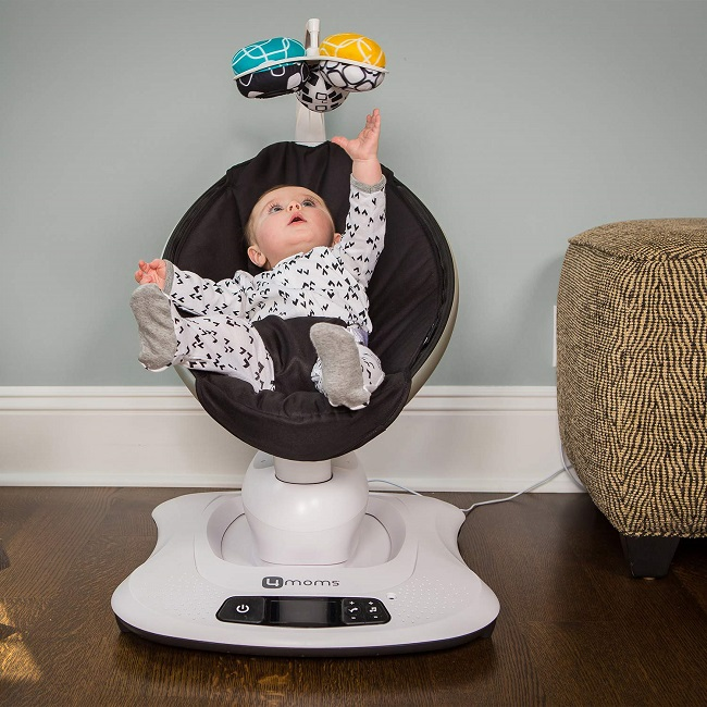 picture of a baby in a bouncer swing