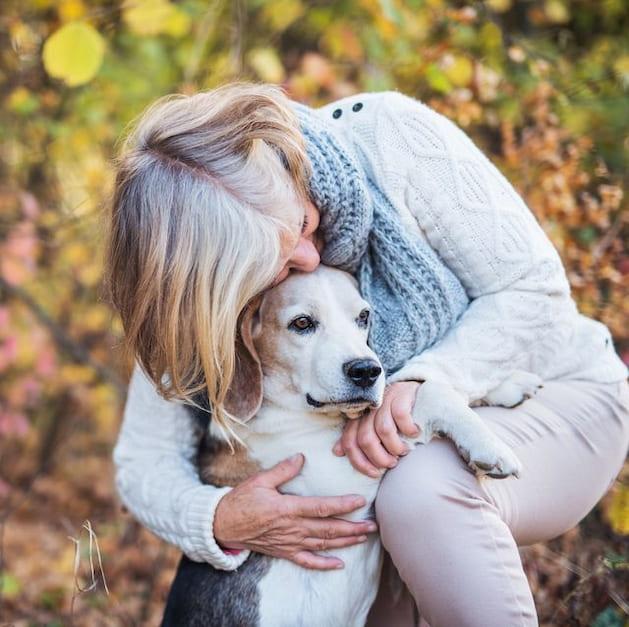 owner hugging her dog