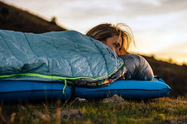 woman in sleeping bag while camping